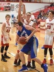 Cotter's Landon Martin makes a move in the paint against Deer in the championship game of the Arvest Bank Tournament on Saturday in Flippin.