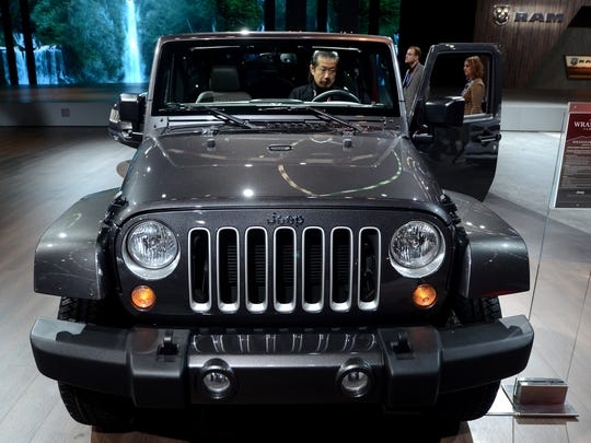 An event goer checks out a new Jeep Wrangler Tuesday,
