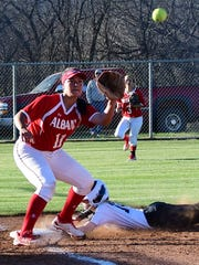 Haskell's Landry Hanson slides into third while Albany's