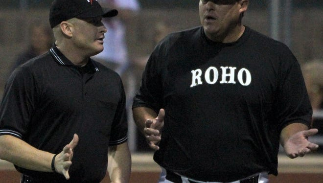 Rider head coach Josh Bobbitt discusses a play with the hme plate umpire during the Raiders' area round series with Aledo on May 13, 2016. Bobbitt was reassigned from his head coaching duties on Monday