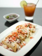 A taco platter at Barrio Queen.