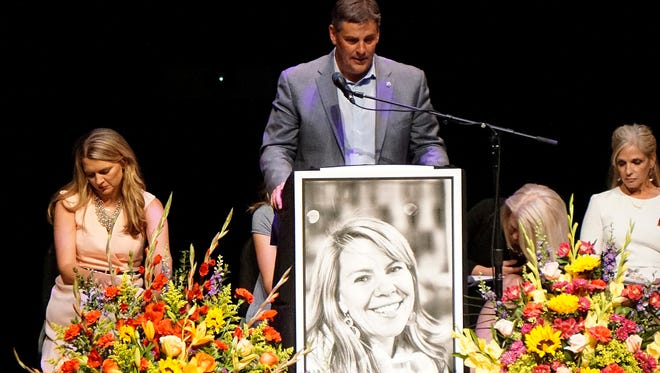 Michael Riordan, center, is joined by family members at a memorial service for his wife Jennifer Riordan, who died on Tuesday in the Southwest Airlines flight 1380 accident, at Popejoy Hall on the campus of the University of New Mexico in Albuquerque, N.M.,  April 22, 2018.