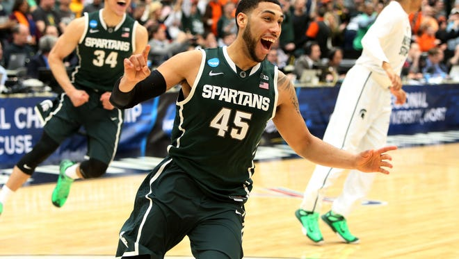 Michigan State's Denzel Valentine celebrates the 76-70 overtime win over  Louisville in the East Regional final on Sunday at Carrier Dome in Syracuse N.Y.