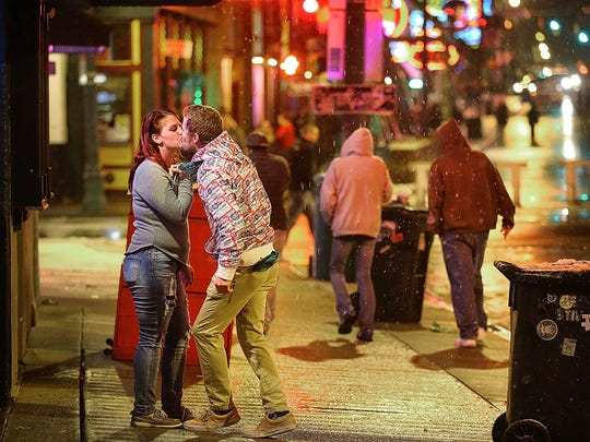 A crowd makes its way down on Beale Street after the Grizzlies game as snow flakes blow around them Saturday evening. After a record-breaking warm February, winter had one last surprise for the Mid-South in the form of a late season snow.