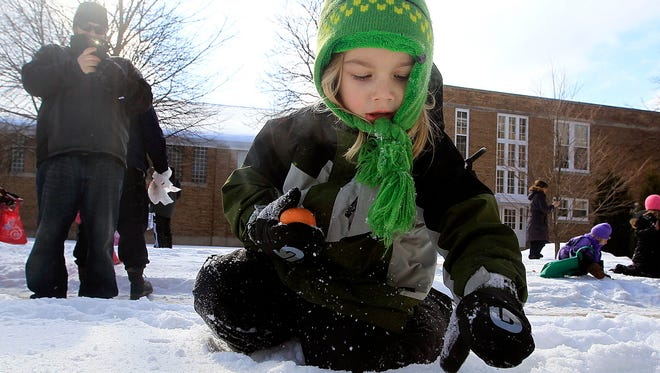 Liam Angeles digs into the snow to retrieve an egg during Cedarburg's 40th annual Winter Festival. The 44th annual Winter Festival is coming up this Saturday.