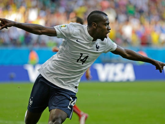 France's Blaise Matuidi celebrates after scoring his side's second goal during the group E World Cup soccer match between Switzerland and France at the Arena Fonte Nova in Salvador, Brazil, Friday, June 20, 2014. (AP Photo/Natacha Pisarenko)