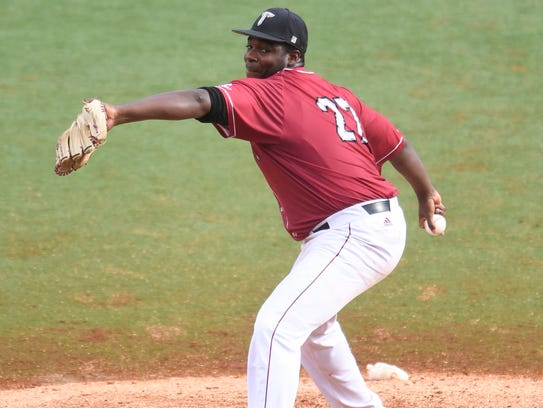 Troy senior pitcher Daren Osby throws against Texas
