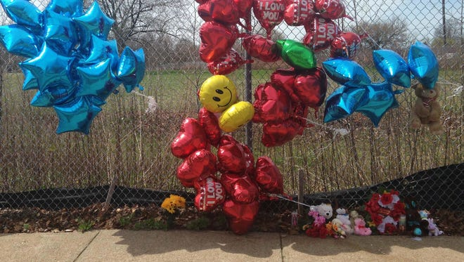 A makeshift memorial sits along a fence Monday, April 17, 2017, near where Robert Godwin Sr., was killed in Cleveland. Police said Steve Stephens killed Godwin on Sunday and posted the video on Facebook.