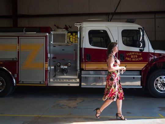 Lee County resident Christy Fogle of Auburn leaves
