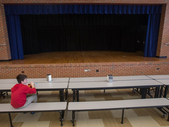 A student at LJ Alleman Middle School eats lunch in