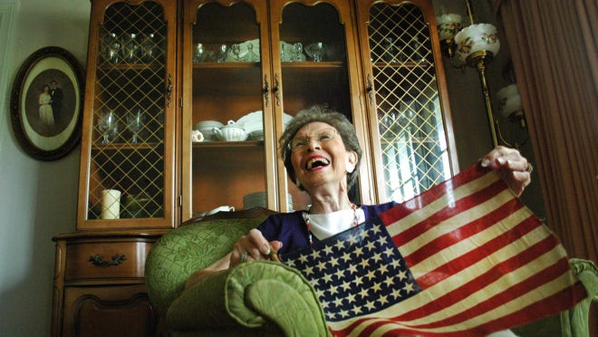 Gallatin resident Bettye Finch Anderson, 80, holds up a 48-star American flag she received as a child in the 1940s during World War II.