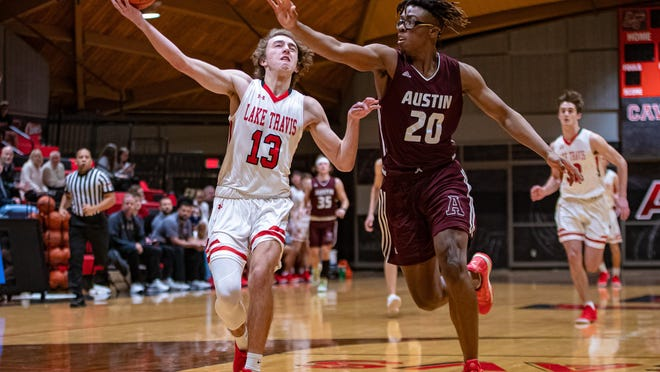 Lake Travis guard Stephen Everett, left, drives in for a layup against Austin High last season. The combo guard returns as one of the Cavs' top weapons.