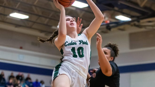 Cedar Park junior Elaine King, driving for a layup against Hutto last season, said the team's family atmosphere is a big reason the Timberwolves have been so successful in recent sesons.