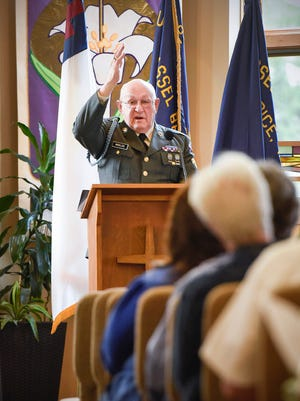 Chaplain Don Miklos says a player for those in the military during the National Day of Prayer service Thursday, April 4, at Shepherd of the Pines Lutheran Church in Rice.