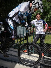 Olympic BMX medalist Alise (Post) Willoughby watches