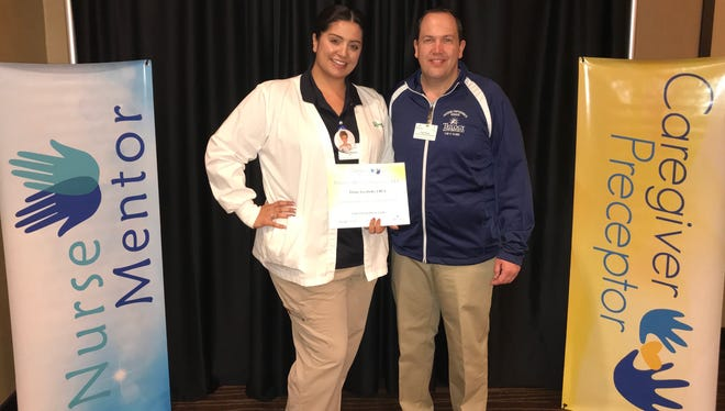 Tiffany Escobedo, 'Caregiver Preceptor' at Valley View, with Chad Pfeifer, director of leadership development.