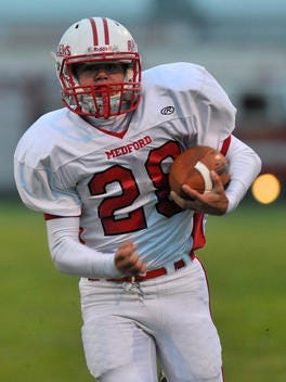 Medford's Conrad Bolz led the Great Northern Conference in rushing yards and touchdowns this season