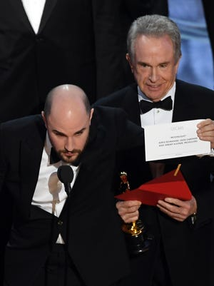 \'La La Land' producer Jordan Horowitz (L) holds up the winner card reading actual Best Picture winner 'Moonlight' with actor Warren Beatty onstage during the 89th Annual Academy Awards at Hollywood & Highland Center on February 26, 2017 in Hollywood, California.