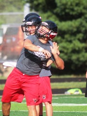 Ludlow QB Justin Blackburn fires a long pass during