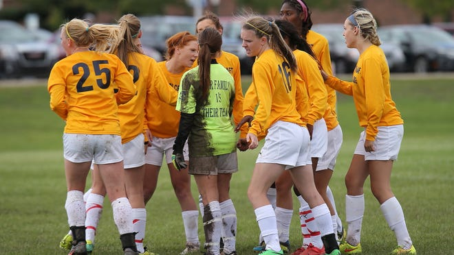 The wet, muddy field and crisp winds didn't deter Schoolcraft College's women's soccer team in Saturday's game against Cincinnati State.