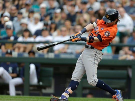 Houston Astros' Josh Reddick hits a two-run single