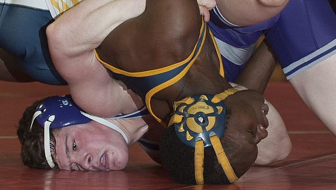 Cherry Hill West's Connor Rogovich, head on left, wrestles against Gabriel Williams of Hamilton North  during their 160-pound bout Wednesday in the Region 7 tournament at Robbinsville High School.