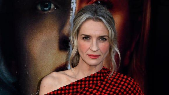 Ever Carradine plays the wife of Commander Warren,