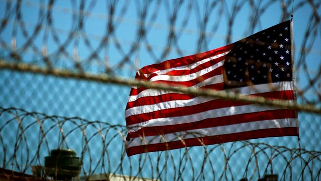 A file photo from September 14, 2005, shows a U.S. flag at Delta Camp 5 on the United States Naval Station in Guantanamo Bay, Cuba. President Obama presented his plans to close the Guantanamo Bay detention center to Congress on Tuesday.