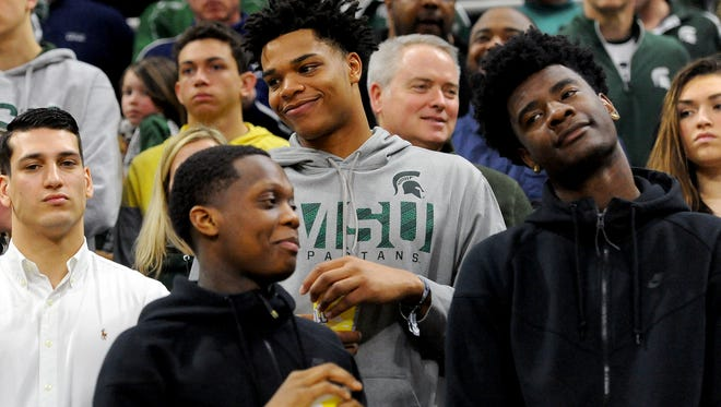 Michigan State basketball target Josh Jackson, right, joins MSU commits Miles Bridges, center, in gray, and Cassius Winston, front left, during MSU's win over Ohio State at Breslin Center earlier this month.