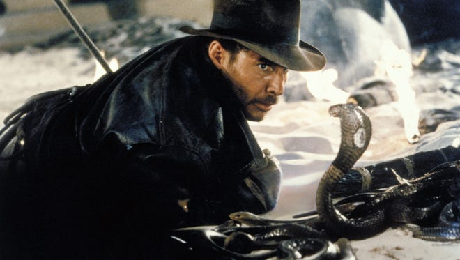 """On Nov.18-20, the Indianapolis Symphony Orchestra will play John Williams's iconic score to 1981's """"Raiders of the Lost Ark"""" as the movie, starring Harrison Ford as Indiana Jones, screens above them."""