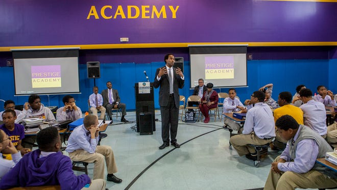 David Johns, executive director of the White House Initiative on Education Excellence for African-Americans, visited the Prestige Academy in Wilmington in 2014. The school is now slated to close next June.