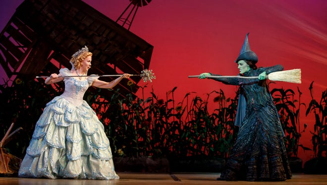 """Ginna Claire Mason, who plays Glinda, left, and Mary Kate Morrissey, who plays Elphaba, in a production of the musical """"Wicked."""""""