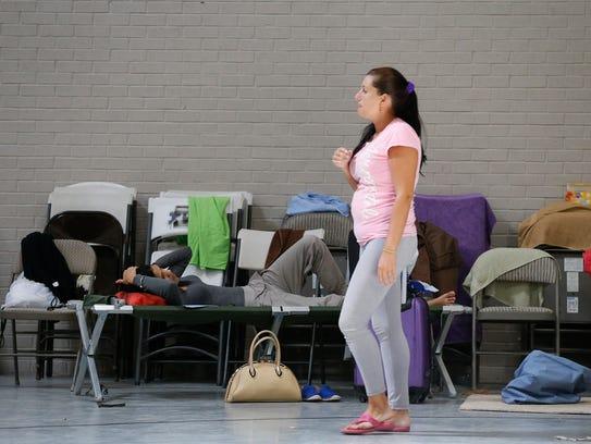 Cuban refugees wait inside the Houchen Community Center