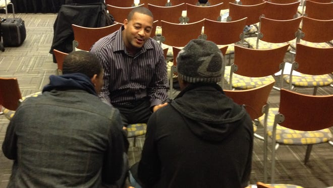 Damon Garfield, 46, of Gates, a volunteer mentor with Operation Transformation Rochester, talks with his mentee and another man on Saturday during a discussion session for OTR's Fresh Start program at the downtown Rochester Educational Opportunity Center.