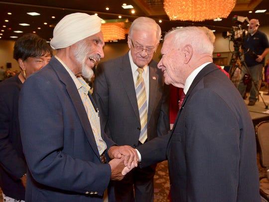 Chain Sandhu of NYX, speaks with Mayor Jack Kirksey and former Mayor Jack Engebretson.
