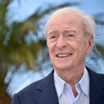 "Michael Caine poses during a photocall for the film ""Youth."""
