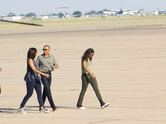 The first family goes to board Air Force One after a visit to the Carlsbad Caverns.