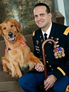 Former Army Capt. Luis Carlos Montalvan and his beloved dog, Tuesday.