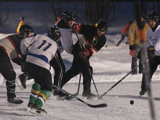 Players battle for the puck at the 2013 Midwest Freeze