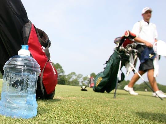 A water bottle sits near the practice area oat the Seminole Golf Course. Athletes especially must  to take water breaks, and dress for the hot weather.