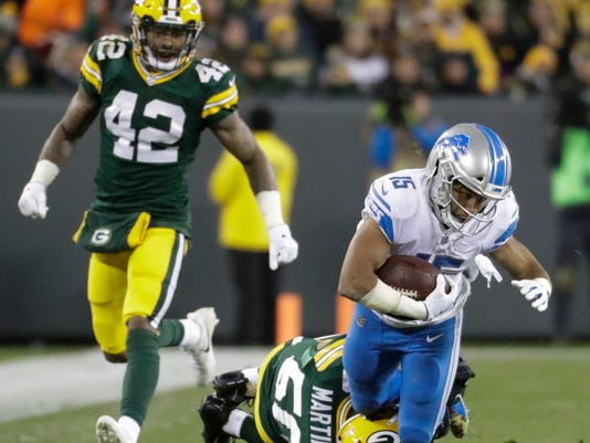 Detroit Lions' Golden Tate is tackled by Green Bay Packers' Blake Martinez after a catch during the second half of an NFL football game Monday, Nov. 6, 2017, in Green Bay, Wis. (AP Photo/Morry Gash)