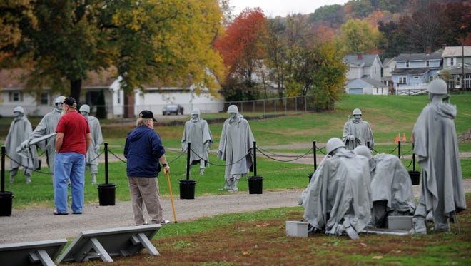 Visitors walk through the traveling replica of the national Korean War Memorial Thursday, Nov. 3, 2016, at the Fairfield County Fairgrounds in Lancaster. The display was part of that weekend's Freedom's Never Free event at the fairgrounds.