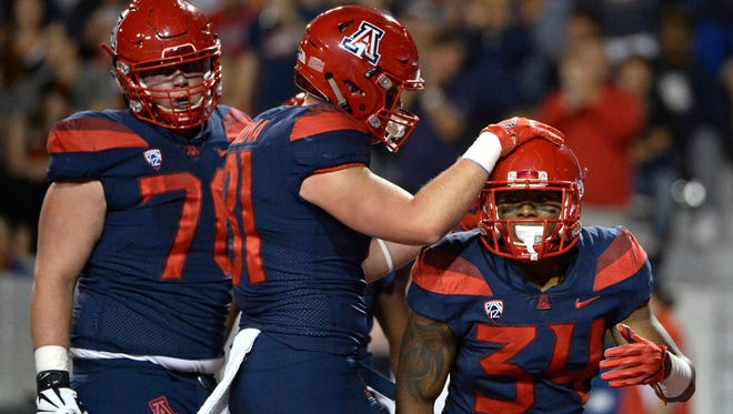 """Arizona lineman Jacob Alsadek (pictured, left) didn't realize how many yards the Wildcats had tallied. """"I thought it was up in the 550s,"""" he said. """"Obviously, that's a big thing for all of us. It's really cool. Especially up front."""""""