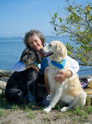 Rita Hallock of Mims with her two therapy dogs, Teagan, left, a cadoodle, and Grace, a labradoodle. Teagan recently had major hip surgery.