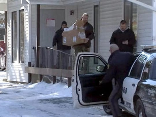 Detectives raid the office of Dr. Liviu Holca on Jan. 24, 2014