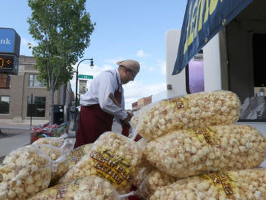 Jay Harwood, of Razor Jay's Old Fashioned Kettle Corn, makes up a fresh batch during a Third Thursday event last year in downtown Marshfield.