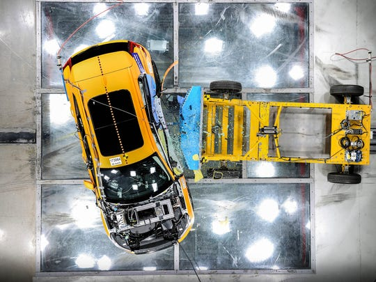 This overhead view shows the 2019 Volvo XC40 SUV in a side impact crash test.
