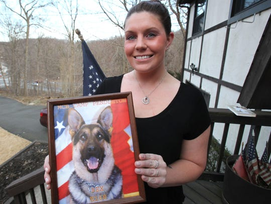 Megan Leavey of Valley Cottage holds a photo of Rex,