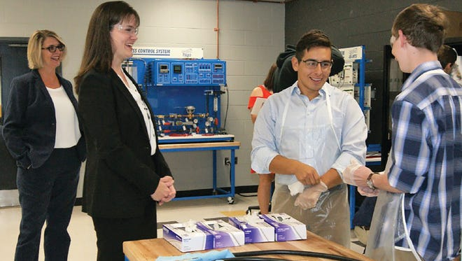 Tennessee Education Commissioner Candice McQueen visits the mechatronics program at Fairview High School.
