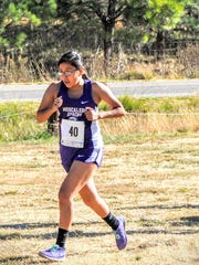 Mescalero's Tierney Shanta ran in the middle of the